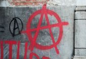 stock photo of anarchists  - Red Spray Paint Anti - JPG