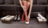 picture of ankle shoes  - part of woman trying on several shoes in the mall - JPG