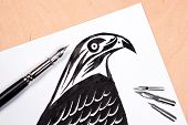 picture of fountains  - Fountain pen with drawing hawk on the wooden background - JPG