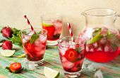 picture of refreshing  - Refreshing summer drink with Strawberry in jug and glasses on the vintage wooden table - JPG