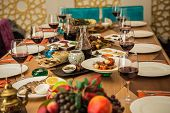 foto of banquet  - Served for a banquet table. Wine glasses with napkins, glasses and salads.