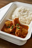pic of curry chicken  - Chicken curry with rice in a disposable container - JPG