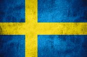 image of sweden flag  - flag of Sweden or Swedish banner on rough pattern texture background - JPG