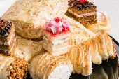 picture of eclairs  - Eclair tasty dessert with cream and powdered sugar - JPG
