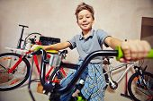 image of adolescent  - Adolescent boy in casualwear sitting on bicycle - JPG
