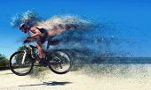 stock photo of dirt-bike  - Pro moutain bike racer running so fast - JPG