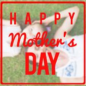 stock photo of daughter  - mothers day greeting against mother and daughter smiling at camera - JPG
