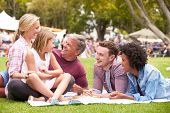 stock photo of grown up  - Older Family Relaxing At Outdoor Summer Event - JPG
