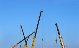foto of boom-truck  - Truck crane boom on blue sky background - JPG