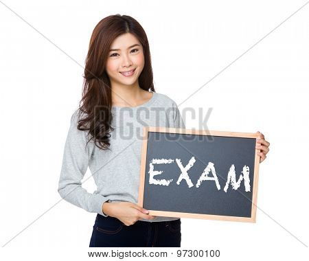 Asian woman hold with black board and showing a word exam