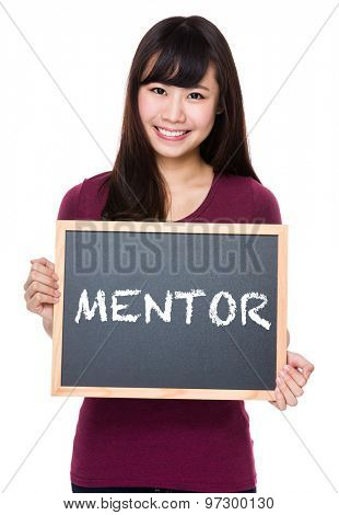 Woman with black board and showing a word mentor
