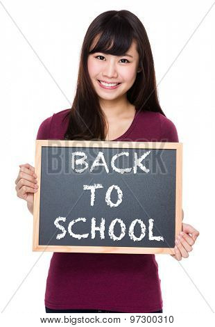 Woman with black board and showing phrase of back to school