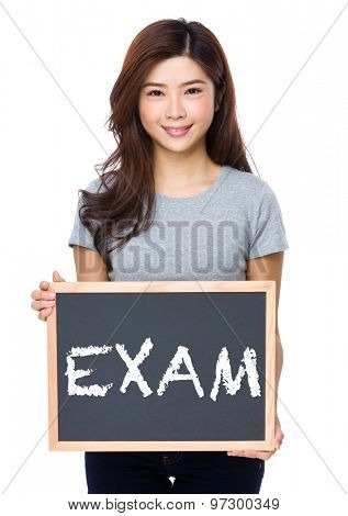 Young woman with chalkboard showing a word exam
