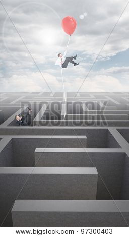 Businessman shooting a bow and arrow against cloudy sky over maze