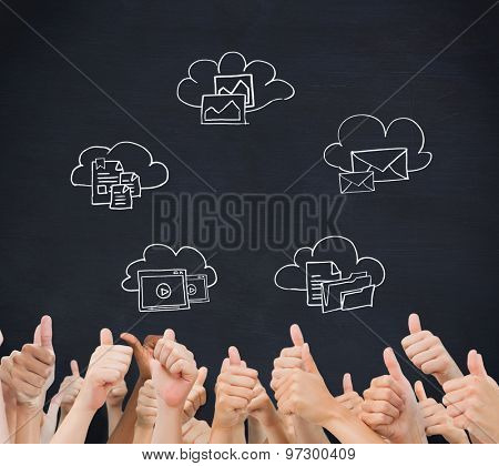 Hands giving thumbs up against blackboard