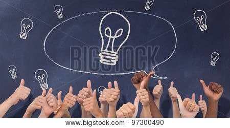 Hands giving thumbs up against speech bubble on chalkboard
