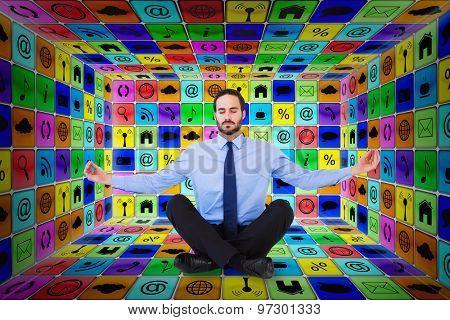 Businessman in suit sitting in lotus pose against app room