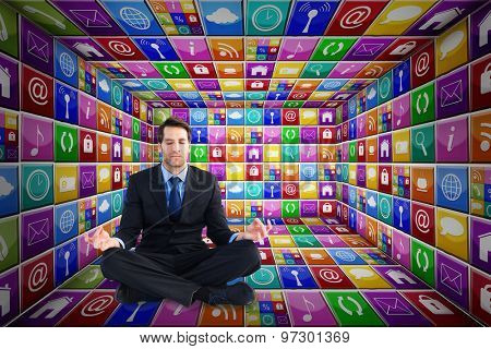 Calm businessman sitting in lotus pose against app room