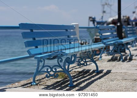 Blue Benches At Seaside