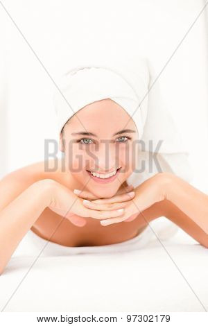 Close-up of an attractive young woman on massage table at spa center