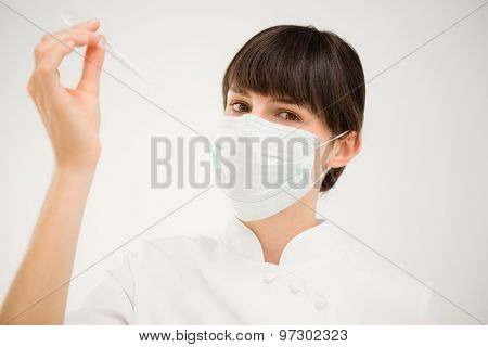 Nurse working with a mask in medical center