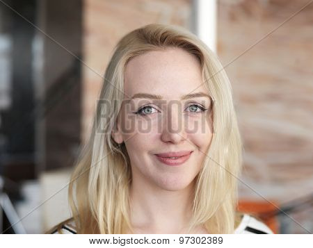 happy young blonde business woman portrait at office