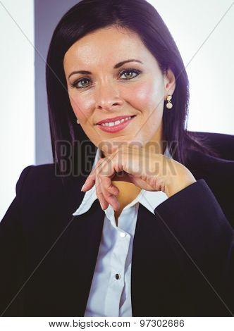 Confident businesswoman looking at camera in her office
