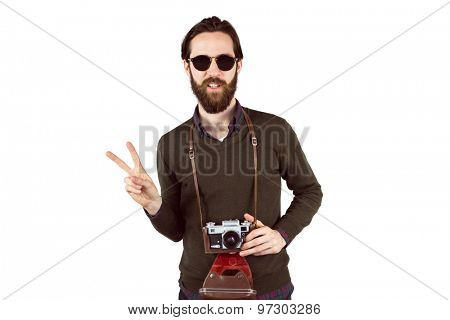 Hipster with his vintage camera on white background