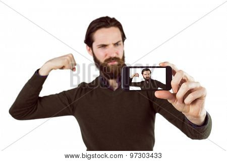 Handsome hipster taking a selfie on white background
