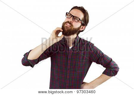 Handsome hipster thinking and scratching beard on white background