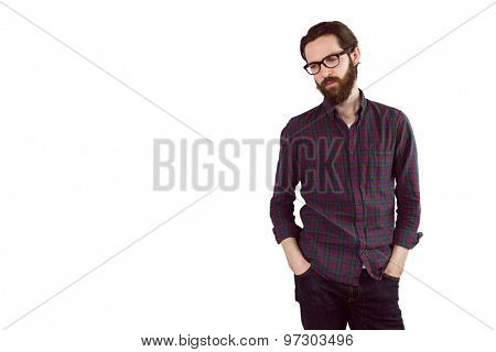 Handsome hipster with hands in pockets on white background