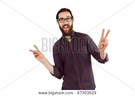 Handsome hipster showing peace sign on white background