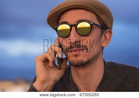 Man Talking On The Phone On The Beach