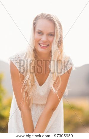 Portrait of a pretty smiling blonde bending over
