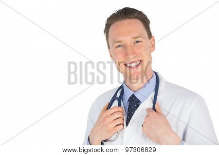Portrait of a doctor holding his stethoscope on white background