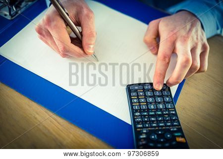 Businessman hands typing and writing in the office