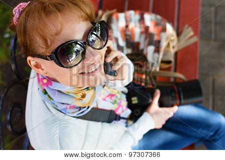 Girl Is Sitting And Talking By Phone