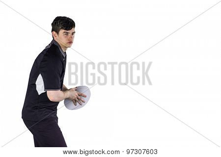 Determined rugby player about to throw a rugby ball