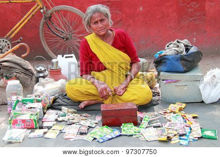 indian woman in bright clothes sells something