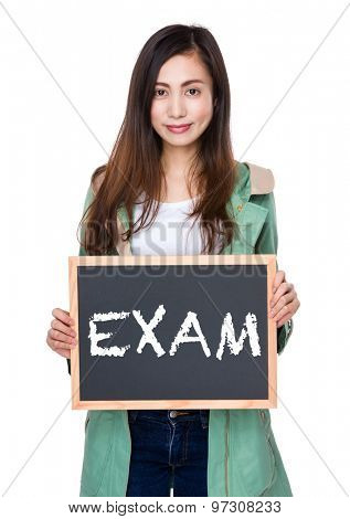 Woman hold with blackboard showing a word exam