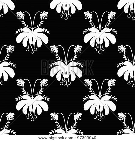 Seamless White Cartoon Flowers Pattern On Black Background