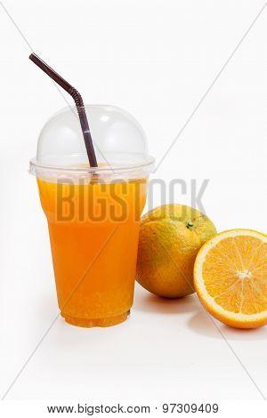 Orange Juice In Plastic Clear Cup And Orange Fruit
