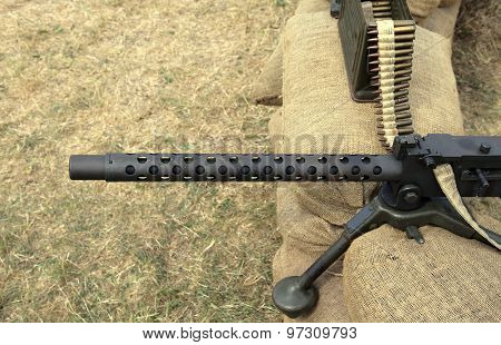 Machine Gun With Bullets Over The Sandbags