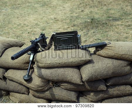 Great Machine Gun With Bullets Over The Sandbags
