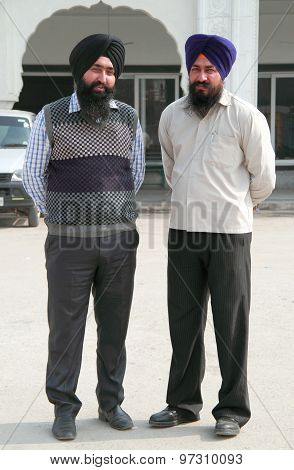 two sikhs look somewhere in Delhi, India