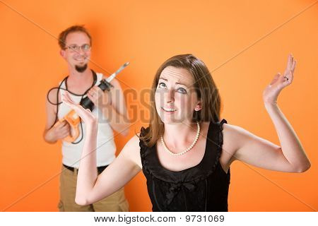 Frustrated Woman And Incompetent Handyman