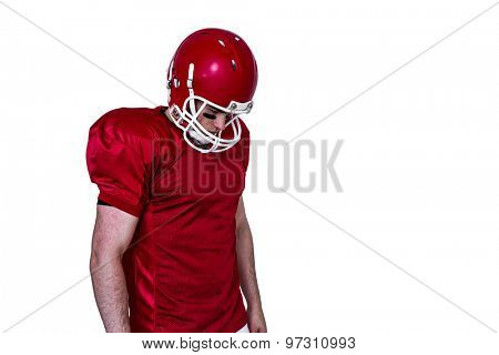 Unsmiling american football player on a white background