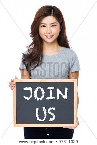 Young woman with chalkboard showing phrase of join us