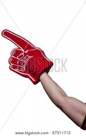 Close up view of an american football player holding supporter foam hand