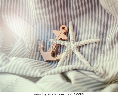 Summer Holiday Concept With Starfish And Toy Anchor
